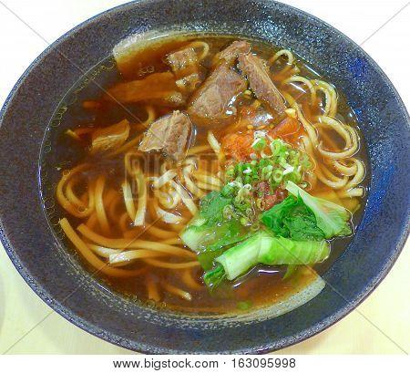 Braised beef noodle soup closeup at restaurant
