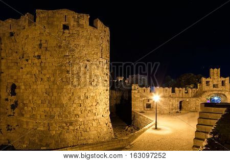 Fortress and lighthouse at the harbor of Rhodes island in Greece