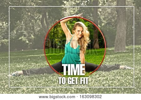 Young female athlete holding a hula hoop in the park. Green grass