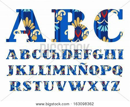 Spanish alphabet, Golden flowers, vector font, capital letters, and blue. The letters of the Spanish alphabet with serifs. Gold and blue flowers on a dark blue background.