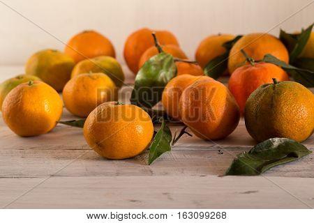 ripe tangerines mandarin on white table yellow tangerine with green leaves