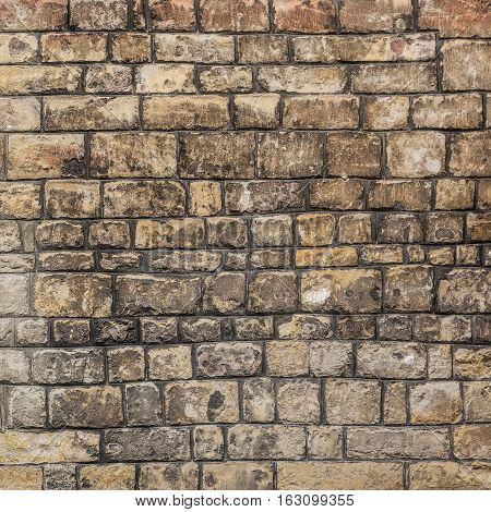 Medieval wall made of stone blocks of irregular size background/texture.