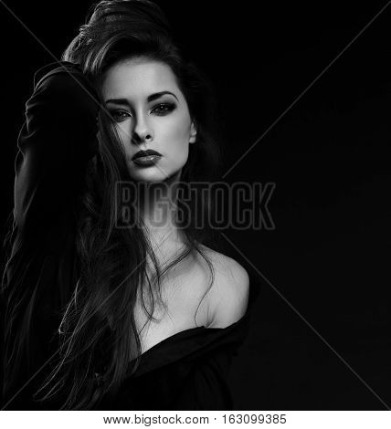 Beautiful Glamour Female Model With Long Brown Hair Posing In Black Shirt On Dark Background And Loo