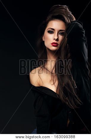 Beautiful Glamour Female Model With Long Brown Hair Posing In Black Shirt On Dark Background With Re