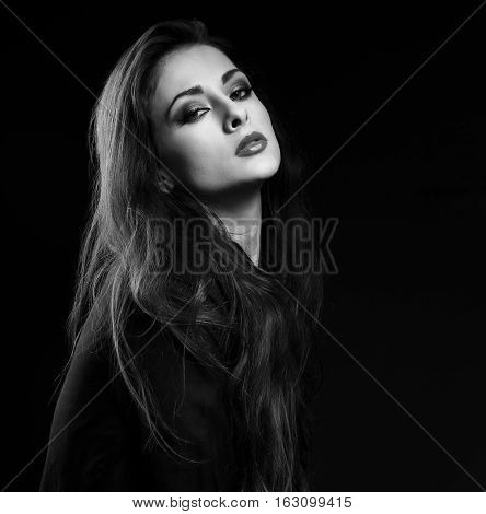 Sexy Female Model With Long Brown Hair Posing In Black Shirt On Dark Background In Dramatic Light. B