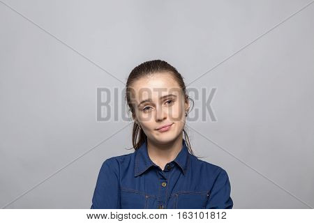 Portrait of bored woman on gray background