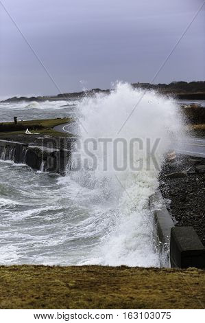 Storm surf smashing against retaining wall along Ocean Drive in Newport Rhode Island