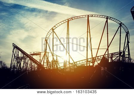 Silhouette of roller coaster in the sunset