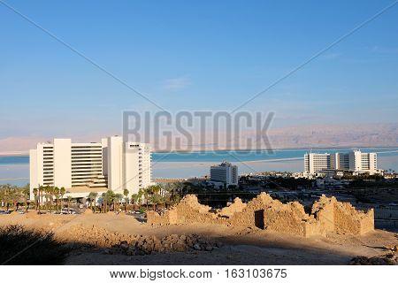 Modern hotels and ancient ruins at Dead Sea coast Israel.