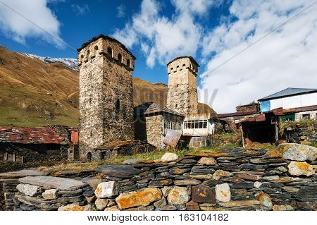 Traditional Svan Towers and machub house with flagstone in Ushguli village Upper Svaneti Georgia. Georgian landmark
