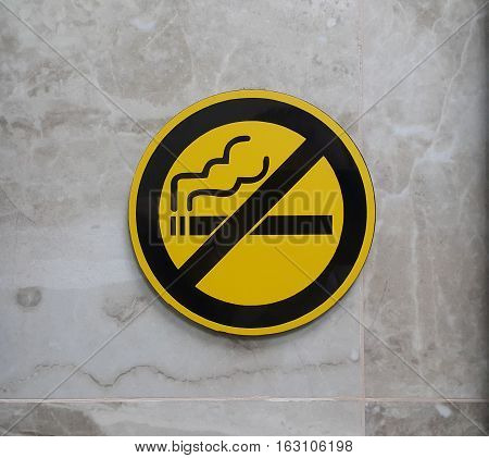 No smoking signage on the wall. No cigarette smoking sign