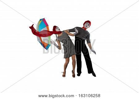 Couple of mimes having fun isolated on white background