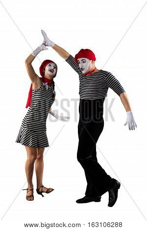Happy couple of mimes having fun isolated on white background