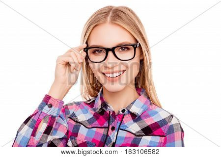 Portrait Of Pretty Young Happy Woman Touching Glasses