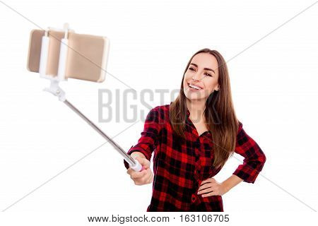 Pretty Young Happy Woman Making Photo With Selfie Stick