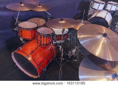 Drums studio in a dark room. Musical instruments