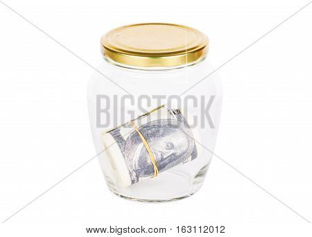 Dollar banknote in glass jar isolated on white background