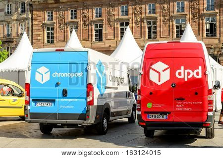 STRASBOURG; FRANCE - JUN 24; 2016: CHRONOPOST DPD and La Poste delivery vans in center of the city. Chronopost and DPD is part of French group La poste