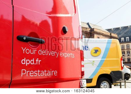 STRASBOURG; FRANCE - JUN 24; 2016: Your delivery experts DPD parcel text on the red postal van in French city of Strasbourg. DPD is an international parcel delivery company owned by GeoPost.