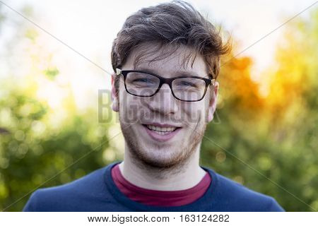 Portrait Of Handsome Young Adult Outdoor With Glasses