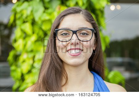 portrait of expressive beautiful girl with glasses outdoors