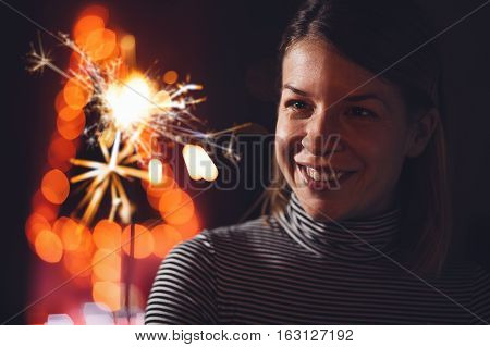 Beautiful bright celebratory sparkler in woman hand