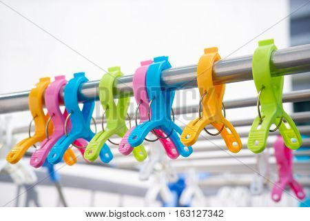Colorful clothes pin on the clothes line