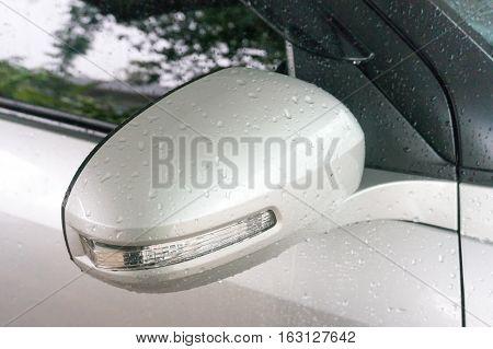 rain drops on car side view mirror