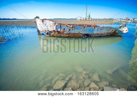 abandoned fishing and shrimp boat near folly beach south carolina