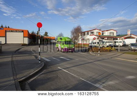 TE ANAU NEW ZEALAND - AUGUST 29 : jucy van popular camper vehicle for rent in new zealand passing street in te anau town important traveling destination in south island on august 292015 in te anau new zealand