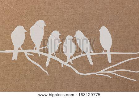closeup of bird silhouettes on brown textile