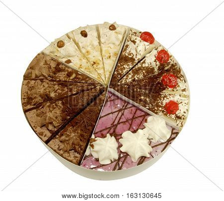 Plate with assorted cake slices on a white background