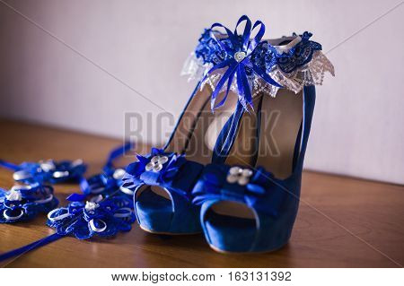 blue bridal woman shoes blue garter,details of attire for the bride