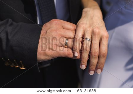 wedding rings on their hands a ring on the finger the bride and groom with rings