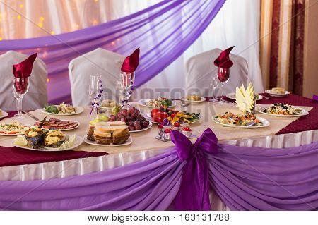 festive wedding table piled with food, wedding decor