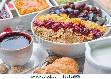 French breakfast on a wooden tray. Daily breakfast