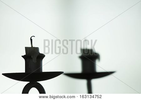 Image of candle reflecting off glass background