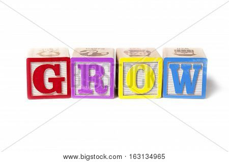 Alphabet blocks spelling the word Grow isolated on white background.