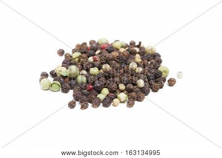 Peppercorns isolated on white background in pile