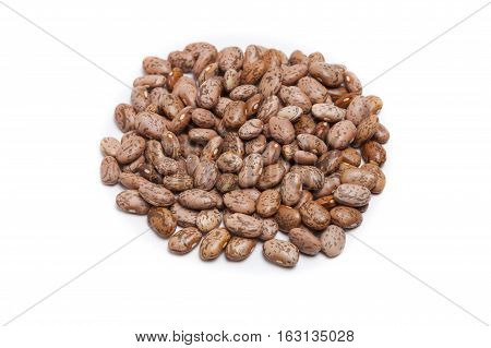 Isolated pinto beans on white background in pile