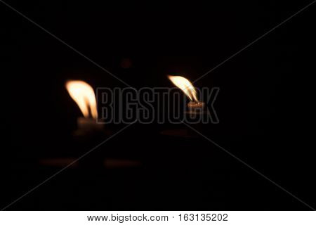 Image of candle reflecting in a mirror