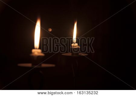 Image of candle light reflecting in a mirror