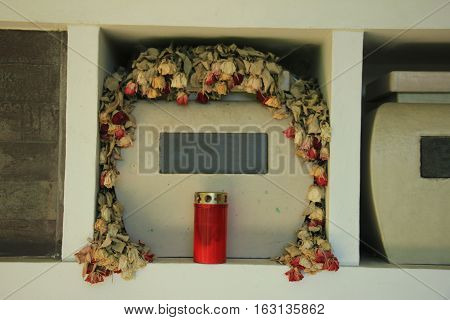 Urn with ashes in a columbarium wall