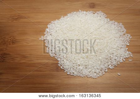 White Rice on wooden cutting board isolated