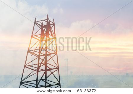 The abstract scene of drop hammer crane structure with the worker on top and the sunset light.