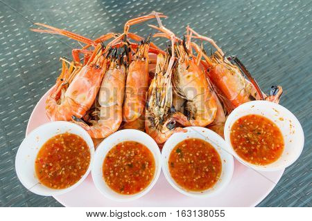 grilled orange shrimp on plate in restaurant