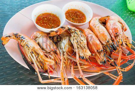 grilled orange shrimp on plate in restaurant
