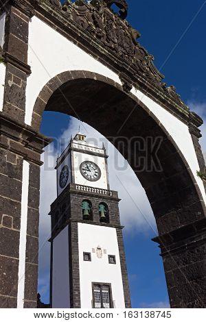 St. Sebastian Church Tower framed in Ponta Delgada town gate. The church located on the Main Square of Ponta Delgada Azores Portugal.
