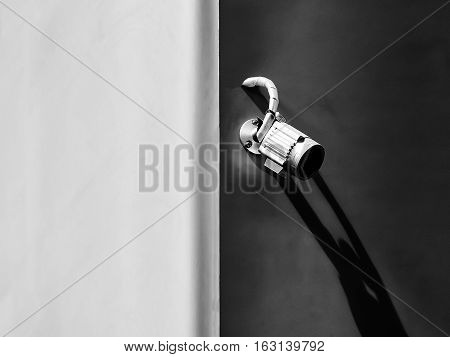 aluminum closed circuit camera for security on the concrete wall black and white tone