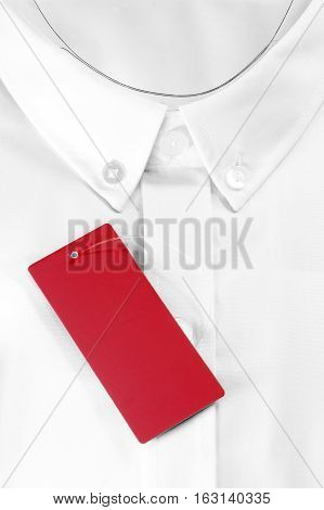 White formal shirt with red sale tag